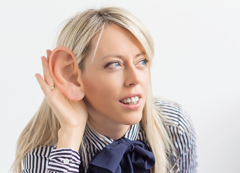 Woman Listening With Ear