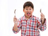 187539116-kid-and-junk-food